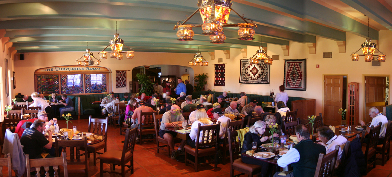 The Turquoise Room dining room full of people eating amazing food